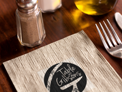 Table at Gibson's Logo